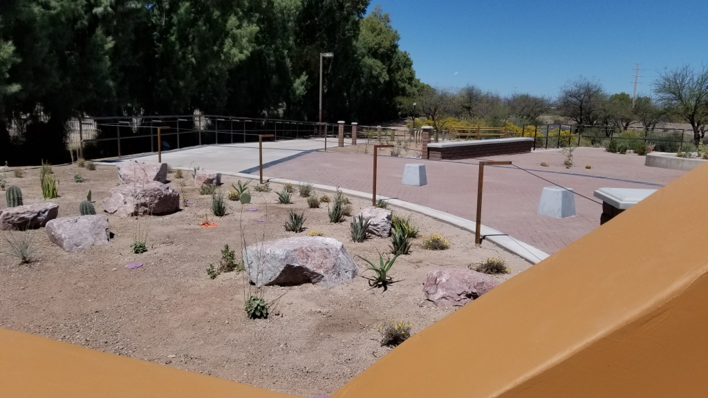 Specimen garden and Braille Cable across entry plaza
